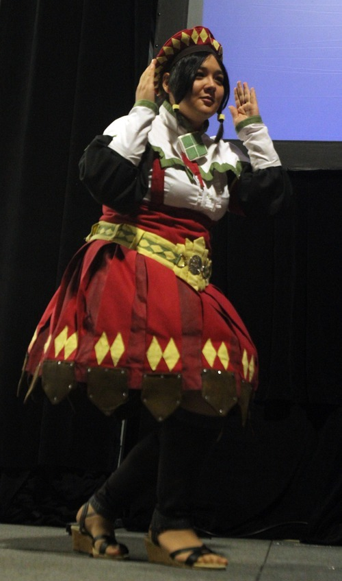 Rick Egan  | The Salt Lake Tribune   Kimi Ushio performs as a guild sweetheart, from Monster Hunter Tri in the Cosplay competition, at the Geex convention, at the South Towne Expo Center, Saturday, October 15, 2011. The GEEX convention is a two-day convention sponsored by MediaOne that's about video games and geek culture.
