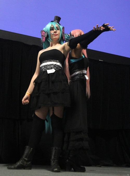 Rick Egan  | The Salt Lake Tribune Olivia Lassig as Hatsune Miku, left, and Megan Love as Megurine Luka perform in the cosplay competitionat the GEEX convention at the South Towne Expo Center on Saturday. The GEEX convention is a two-day convention sponsored by MediaOne that is about video games and geek culture.