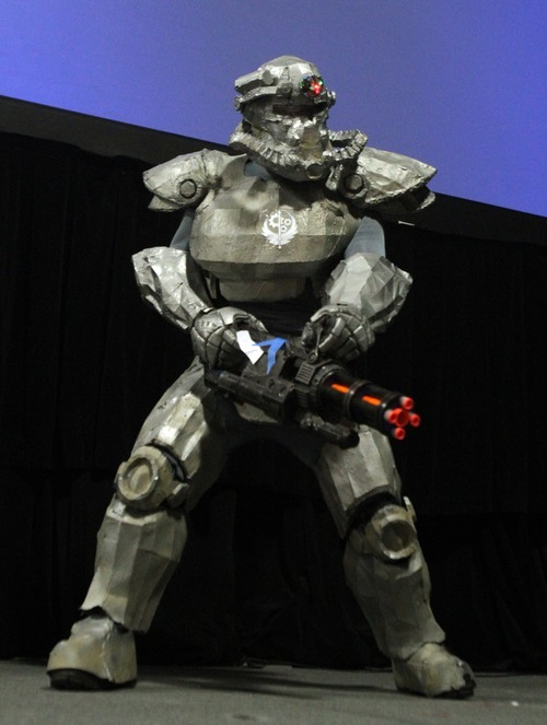 Rick Egan  | The Salt Lake Tribune   Brad Broadhead performs as T-51 in his power armor suit in the Cosplay competition at the Geex convention at the South Towne Expo Center, Saturday, October 15, 2011. The GEEX convention is a two-day convention sponsored by MediaOne that's about video games and geek culture.