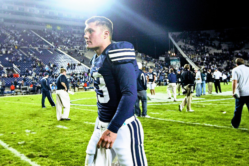 Photo by Chris Detrick  |  The Salt Lake Tribune  Brigham Young's Riley Nelson #13 walks off the field after the game at LaVell Edwards Stadium Friday October 2, 2009. BYU won the game 35-17.