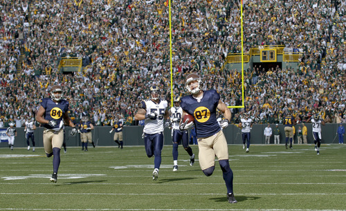 Green Bay Packers wide receiver Jordy Nelson runs for a 93-yard touchdown against the St. Louis Rams during the first half of an NFL football game Sunday, Oct. 16, 2011, in Green Bay, Wis. In back is St. Louis Rams middle linebacker James Laurinaitis (55). (AP Photo/Jeffrey Phelps)