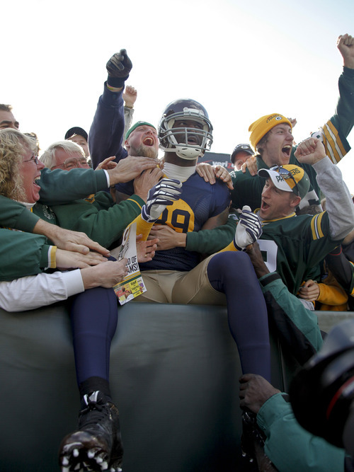 Green Bay Packers wide receiver James Jones briefly sits after doing a Lambeau Leap following his touchdown against the St. Louis Rams, during the first half of an NFL football game Sunday, Oct. 16, 2011, in Green Bay, Wis. (AP Photo/Jeffrey Phelps)