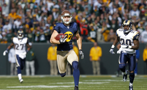 Green Bay Packers wide receiver Jordy Nelson runs for a 93-yard touchdown against St. Louis Rams' Quintin Mikell (27) and Darian Stewart during the first half of an NFL football game Sunday, Oct. 16, 2011, in Green Bay, Wis. (AP Photo/Jeffrey Phelps)