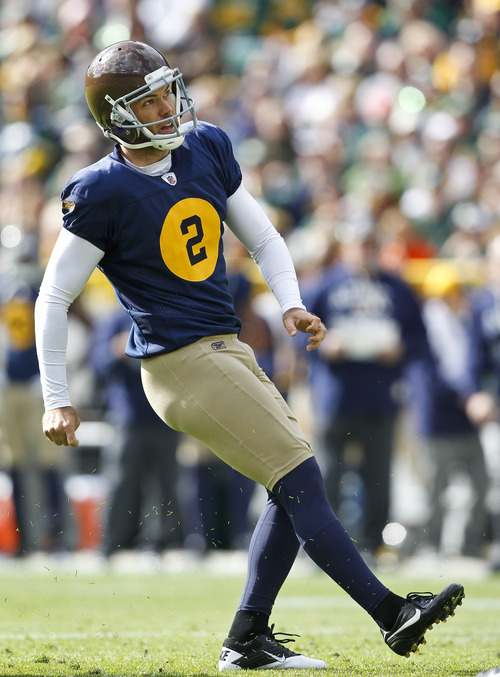 Green Bay Packers kicker Mason Crosby (2) kicks a field goal during the first half of an NFL football game against the St. Louis Rams Sunday, Oct. 16, 2011, in Green Bay, Wis. (AP Photo/Jeffrey Phelps)