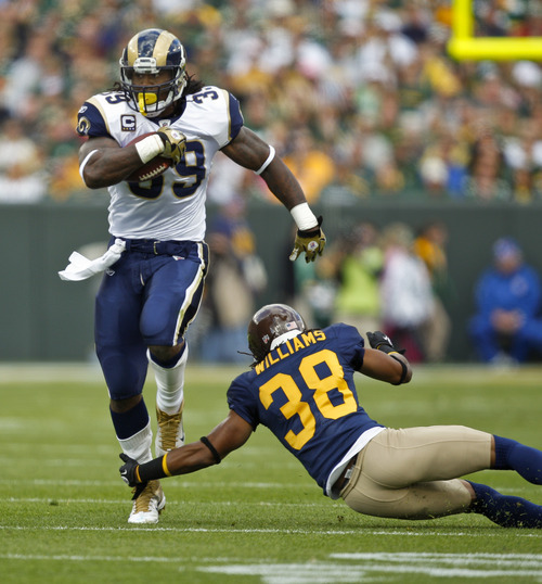 St. Louis Rams defensive back Josh Gordy (39) runs past the reach of Green Bay Packers cornerback Tramon Williams (38) during the first half of an NFL football game Sunday, Oct. 16, 2011, in Green Bay, Wis. (AP Photo/Andy Manis)
