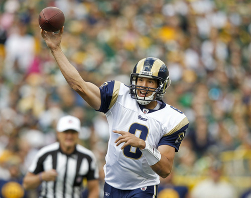 St. Louis Rams quarterback Sam Bradford (8) throws against the Green Bay Packers during the first half of an NFL football game Sunday, Oct. 16, 2011, in Green Bay, Wis. (AP Photo/Jeffrey Phelps)