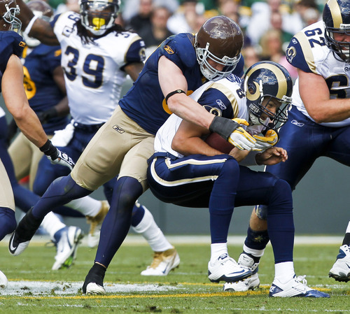 Green Bay Packers inside linebacker A.J. Hawk sacks St. Louis Rams quarterback Sam Bradford during the first half of an NFL football game Sunday, Oct. 16, 2011, in Green Bay, Wis. (AP Photo/Jeffrey Phelps)