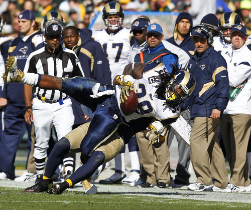 Green Bay Packers inside linebacker Desmond Bishop takes down St. Louis Rams running back Steven Jackson (39) during the second half of an NFL football game Sunday, Oct. 16, 2011, in Green Bay, Wis. The Packers won 24-3. (AP Photo/Jeffrey Phelps)
