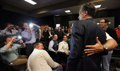 Republican presidential candidate former Massachusetts Gov. Mitt Romney poses for photos after speaking at Microsoft headquarters Thursday, Oct. 13, 2011, in Redmond, Wash. (AP Photo/Elaine Thompson)