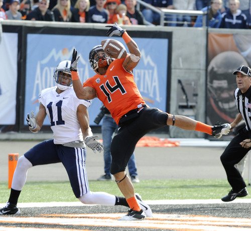 Oregon State's Jordan Poyer (14) knocks down a pass meant for BYU's  Ross Apo (11) during the second half of an NCAA college football game in Corvallis, Ore., Saturday Oct. 15, 2011. (AP Photo/Greg Wahl-Stephens)