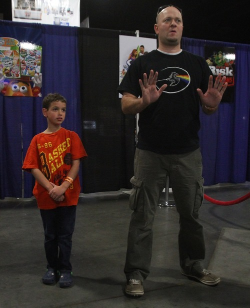 Rick Egan  | The Salt Lake Tribune  Tom Long and his 8-year-old son, Mason, attend the Geex Convention at the South Towne Expo Center on Saturday. A BYU study says profanity is a gateway to violence. The study looks at exposure to profanity from many sources, including games and other media.