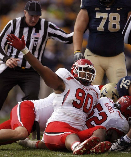 Trent Nelson  |  The Salt Lake Tribune Utah's Derrick Shelby signals Utah's recovery of a Pitt fumble during the second half. Utah vs. Pitt, college football at Heinz Field Stadium in Pittsburgh, Pennsylvania, Saturday, October 15, 2011.