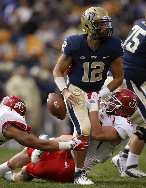 Trent Nelson  |  The Salt Lake Tribune Utah's Joe Kruger strips the ball from Pitt quarterback Tino Sunseri during the second half. Utah recovered the ball. Utah vs. Pitt, college football at Heinz Field Stadium in Pittsburgh, Pennsylvania, Saturday, October 15, 2011.