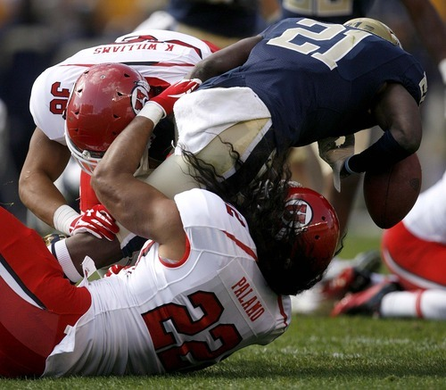 Trent Nelson  |  The Salt Lake Tribune Pitt's Buddy Jackson fumbles the ball as he's tackled by Utah's Tyler Whittingham (36) and Thretton Palamo (22) during the second half. Utah vs. Pitt, college football at Heinz Field Stadium in Pittsburgh, Pennsylvania, Saturday, October 15, 2011.