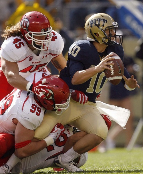 Trent Nelson  |  The Salt Lake Tribune Utah's Joe Kruger (99), Boo Andersen (45) and Matt Martinez (52) sack Pitt quarterback Trey Anderson during the second half. Utah vs. Pitt, college football at Heinz Field Stadium in Pittsburgh, Pennsylvania, Saturday, October 15, 2011.