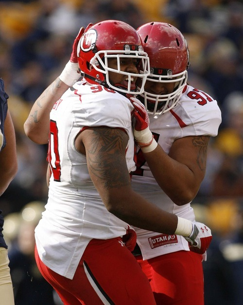 Trent Nelson  |  The Salt Lake Tribune Utah's Derrick Shelby, left, and Tevita Finau celebrate a Shelby sack during the second half. Utah vs. Pitt, college football at Heinz Field Stadium in Pittsburgh, Pennsylvania, Saturday, October 15, 2011.
