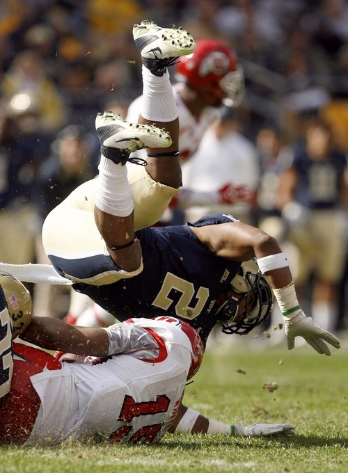 Trent Nelson  |  The Salt Lake Tribune Pitt's K'Waun Williams tackles Utah's John White during the second half. Utah vs. Pitt, college football at Heinz Field Stadium in Pittsburgh, Pennsylvania, Saturday, October 15, 2011.