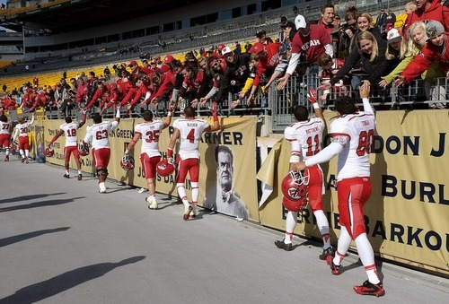 Trent Nelson  |  The Salt Lake Tribune Utah reach out to their fans following the win. Utah vs. Pitt, college football at Heinz Field Stadium in Pittsburgh, Pennsylvania, Saturday, October 15, 2011.