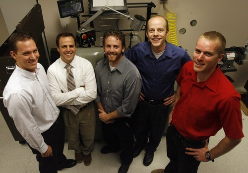 Rick Egan  | The Salt Lake Tribune  Stuart Curtis, Erik Ostler, Derek Bradley, Matt Sorensen and Brent Call in their lab at Research Park. Sorensen is president of the Bench to Bedside Medical Device Competition.