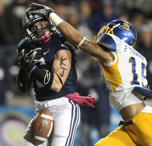 Rick Egan  | The Salt Lake Tribune   Brigham Young Cougars wide receiver McKay Jacobson (6) lets the ball slip between his hands as San Jose State Spartans cornerback Peyton Thompson (19) defends on the play, in football action, BYU vs. San Jose State, at Lavell Edwards stadium, Saturday, October 8, 2011.