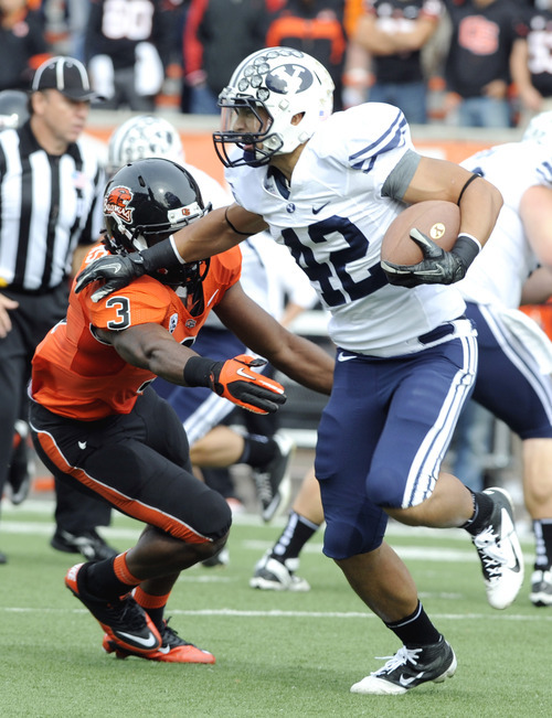 Oregon State's Anthony Watkins chases BYU's Michael Alisa (42) during the first half of an NCAA college football game in Corvallis, Ore., Saturday, Oct. 15, 2011. (AP Photo/Greg Wahl-Stephens)