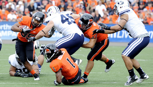 Oregon State's Malcolm Agnew (35) runs against BYU's Tyler Beck (45) during the first half of an NCAA college football game in Corvallis, Ore., Saturday Oct. 15, 2011. (AP Photo/Greg Wahl-Stephens)