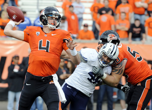 Oregon State's quarterback Sean Mannion (4) throws against BYU during the first second half of an NCAA college football game in Corvallis, Ore., Saturday Oct. 15, 2011. (AP Photo/Greg Wahl-Stephens)