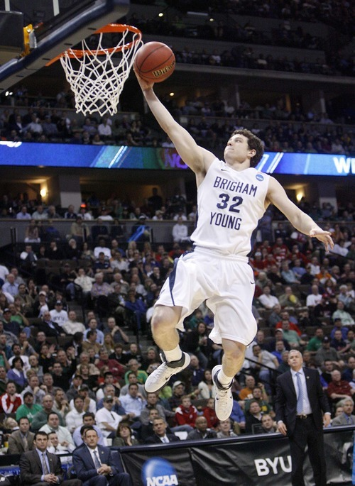 Trent Nelson  |  The Salt Lake Tribune BYU's Jimmer Fredette scores an easy basket in the second half as BYU faces Wofford in the NCAA Tournament, men's college basketball at the Pepsi Center in Denver, Colorado, Thursday, March 17, 2011.