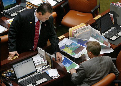 Scott Sommerdorf  |  The Salt Lake Tribune               House Rep. Carl Wimmer, R-Herriman, left, speaks with Rep. Chris Herrod, R-Provo, about redistricting maps as the House returned from caucus Monday. Wimmer is a declared candidate for the 4th Congressional District -- an announcement he made long before new boundaries were drawn.