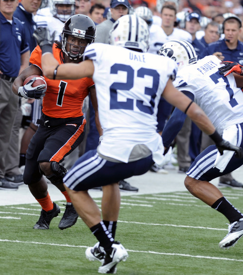 Oregon State's James Rodgers (1) runs the sideline against BYU's Travis Uale (23) and Preston Hadley (7) during the first half of an NCAA college football game in Corvallis, Ore., Saturday Oct. 15, 2011. (AP Photo/Greg Wahl-Stephens)