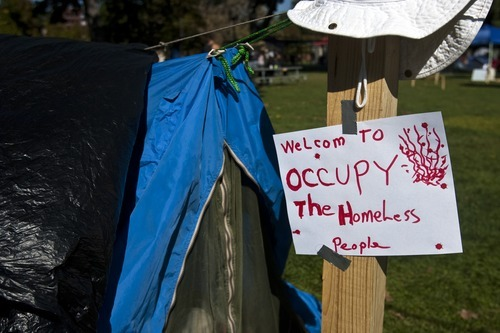 Chris Detrick     The Salt Lake Tribune A sign outside of a tent at the Occupy SLC camp at Pioneer Park Tuesday October 18, 2011.