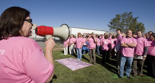 Paul Fraughton | The Salt Lake Tribune GE Healthcare employees  get some last minute instructions as they prepare to form a human cancer awareness ribbon in a field next to their Salt Lake City  facilities.   Wednesday, October 19, 2011