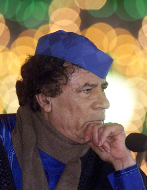 In this February 2001 photo, Libyan leader Moammar Gadhafi listens to questions during a news conference in Tripoli. Libya's information minister said Gadhafi was killed Thursday, Oct. 20, 2011, when revolutionary forces overwhelmed his hometown, Sirte, the last major bastion of resistance two months after the regime fell. (AP Photo/Amr Nabil)