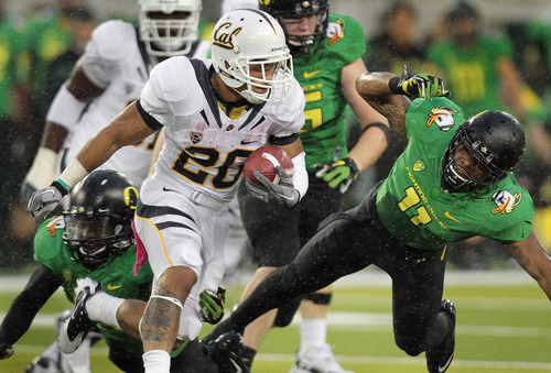 California tailback Isi Sofele (20), who played prep football at Cottonwood High, has become a rushing star for the Golden Bears. Cal plays host to Utah Saturday in San Francisco. (AP Photo/Don Ryan)
