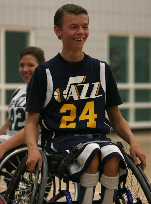 Leah Hogsten | The Salt Lake Tribune Spencer Heslop, 17, works out with fellow members of the Wheelin' Jazz basketball team at the Sorenson Multicultural Center. Heslop is a Clearfield High senior who just returned from the Netherlands, where he participated in a Paralympic camp.
