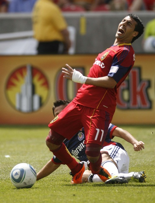 Trent Nelson  |  The Salt Lake Tribune Real Salt Lake's Javier Morales falls with a horrific injury, with Chivas USA's Marcos Mondaini defending. Real Salt Lake vs. Chivas USA, MLS Soccer at Rio Tinto Stadium in Sandy, Utah, Saturday, May 7, 2011.