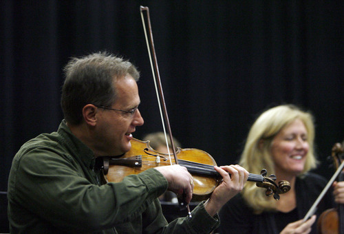 Francisco Kjolseth  |  The Salt Lake Tribune Utah Symphony violinist David Langr rehearses for the NOVA Chamber Music Series alongside his wife, Kathy Langr, at the Utah Opera Production Studios. The opening concert of the 2011-12 NOVA Series on Oct. 23 included a performance of Wagner's