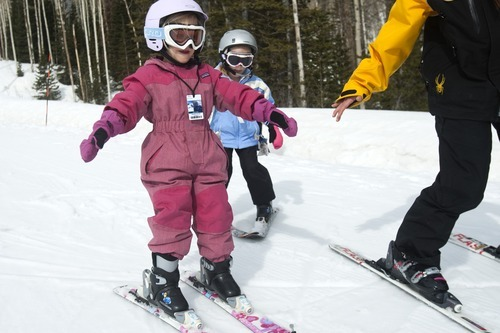 Chris Detrick | The Salt Lake Tribune  Melissa Wagner teaches Aisling Taylor, 3, and Alexandra Hammons, 5, how to ski at Canyons Ski Resort on April 2, 2011.