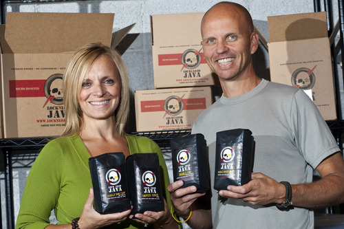 Chris Detrick  |  The Salt Lake Tribune Lock-N-Load Java founders Carl and Lori Churchill pose for a portrait with some of their coffee Wednesday October 5, 2011. Carl, an army combat veteran with 21 years of service as both an enlisted soldier and officer, launched the internet coffee company in March. Lock-N-Load Java currently has nine varietals of coffee for sale on their website http://www.locknloadjava.com/