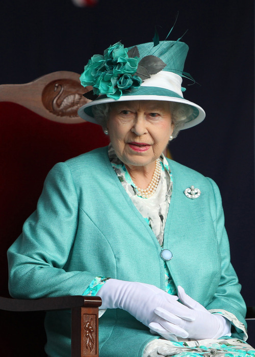 Queen Elizabeth II sits in a chair during a state reception at Government House in Perth, Australia, on Thursday, Oct. 27, 2011. The queen, on her first visit to Australia since 2006, will attend the biennial Commonwealth Heads of Government Meeting during her stay in Perth. (AP Photo/Lincoln Baker, Pool)