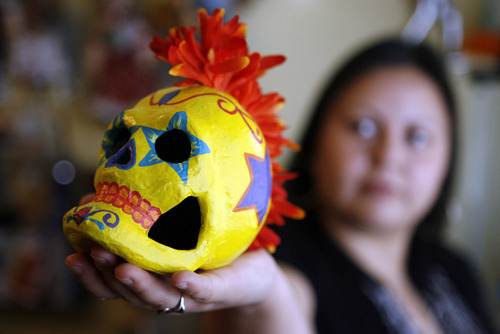 Francisco Kjolseth  |  The Salt Lake Tribune Veronica Perez is a Utah artist who has playfully taken Day of the Dead images and concepts of the holiday a step further with her modern spin -- punker skulls, etc. -- and reconnected with her cultural roots through the imagery of the traditional holiday.