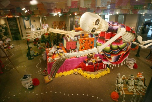 Steve Griffin  |  The Salt Lake Tribune   A skeleton hangs from the ceiling at the Utah Cultural Celebration Center's Day of the Dead Altar exhibits in West Valley City on Oct. 24, 2011. The exhibit runs through Nov. 3, 2011.