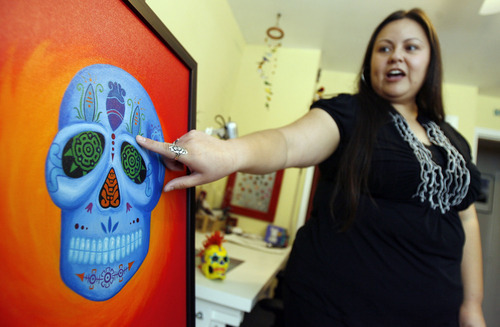 Francisco Kjolseth  |  The Salt Lake Tribune Local artist Veronica Perez points out the symbolism of her piece