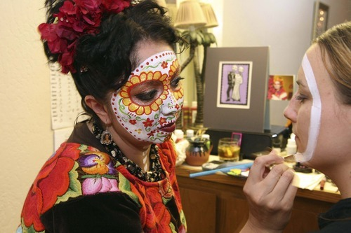 Marla Colmenero paints a girl's face in the tradition of the mythical La Catrina. (Courtesy photo by Robb Norbutt)