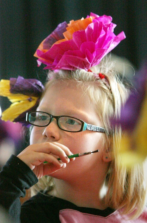 Steve Griffin  |  The Salt Lake Tribune   Mill Creek Elementary School second-grader Natalie Dahlquist wears the crepe paper flowers she made during her school's visit to the Utah Cultural Celebration Center's Day of the Dead Altar exhibits in West Valley City on Oct. 24, 2011.