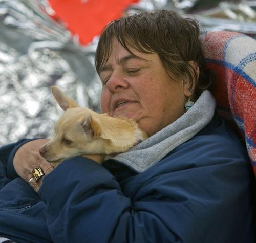 Al Hartmann  |  The Salt Lake Tribune Cynthia Cook, who is in a wheelchair, tucks her friend's dog