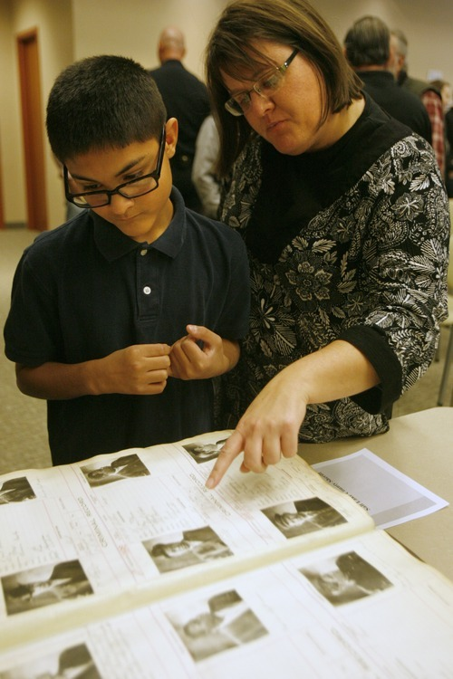 Rick Egan  | The Salt Lake Tribune  Dakota Stringham, 12, looks through the 1914 Criminal record book with his mother, Heidi, Friday. The record books are part of the Law Enforcement Historical Collection on display at the Utah State Archives building, along with other interesting items and photographs from the state's law enforcement past, including old firearms, photographs, badges, equipment.
