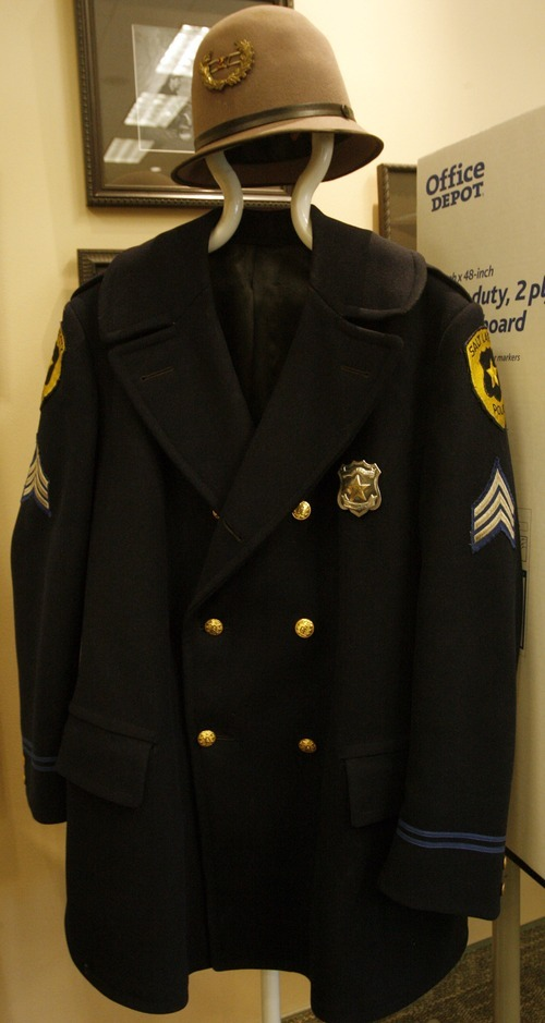 Rick Egan  | The Salt Lake Tribune  Old police uniforms are on display at the Law Enforcement Historical Collection at the Utah State Archives building. Other interesting items and photographs from the state's law enforcement past, including old firearms, photographs, badges, equipment and mugshot books, are also on display.