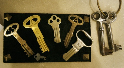 Rick Egan  | The Salt Lake Tribune  Old prison keys are one of the many items on display at the Law Enforcement Historical Collection at the Utah State Archives building Friday. The collection contains other interesting items and photographs from the state's law enforcement past, including old firearms, photographs, badges, equipment and mugshot books.