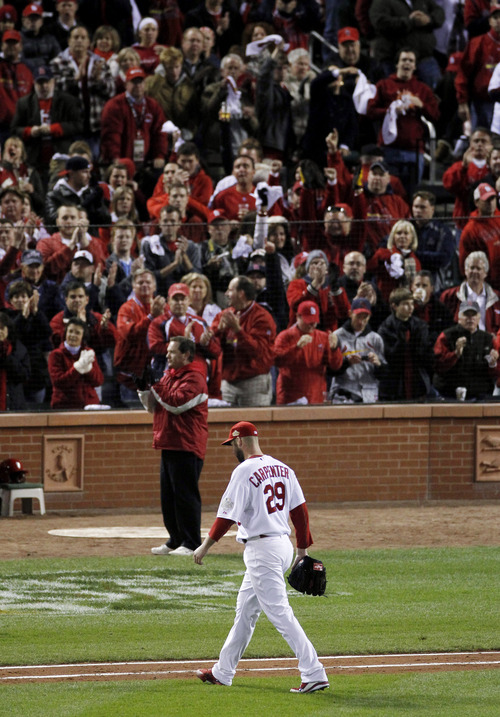 St. Louis Cardinals' Chris Carpenter leaves the game during the seventh inning of Game 7 of baseball's World Series Friday, Oct. 28, 2011, in St. Louis. (AP Photo/Jeff Roberson)